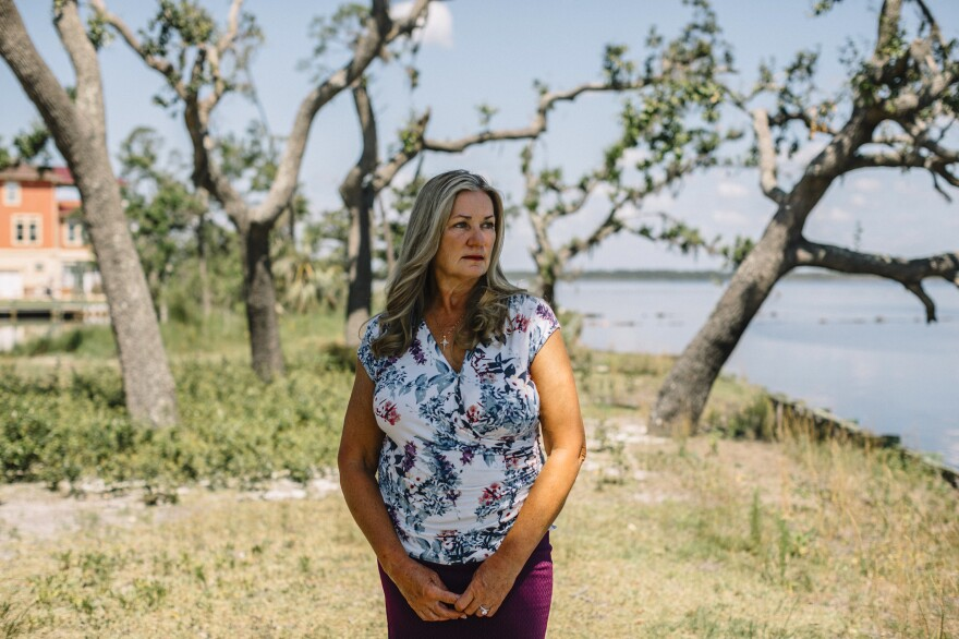 Lynn Haven Mayor Margo Anderson stands near the water on the north side of town. Much of Lynn Haven sustained catastrophic damage in the hurricane last year.