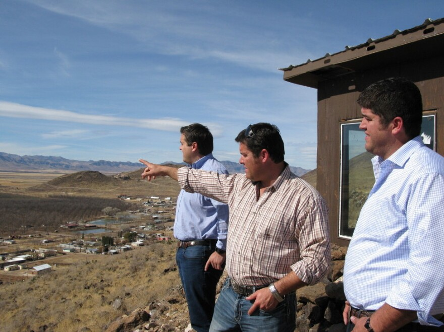 Alex, Daniel and Max LeBaron look out over Colonia LeBaron in Chihuahua, Mexico, in front of a shack they built as a lookout against approaching criminals. The murder of two citizens galvanized this community to protect itself, Alex says.