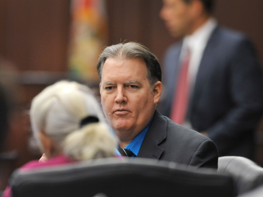 Michael Dunn talks with a member of his defense team during the first break in his retrial at the Duval County Courthouse in Jacksonville, Fla., in September.