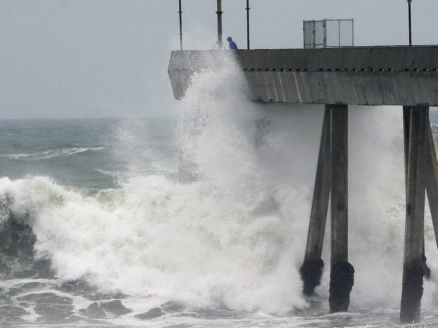 A man observes crashing waves from the Pacifica Pier in Pacifica, Calif., in January.