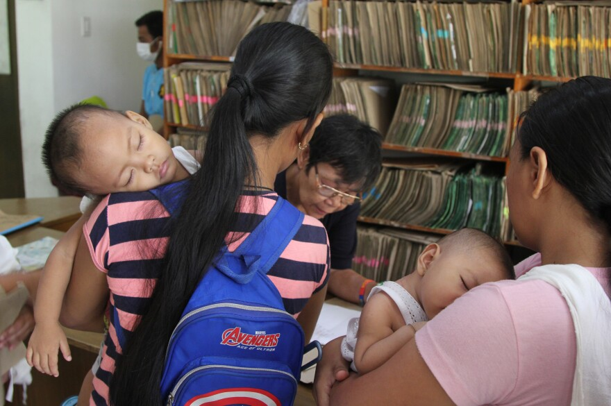 At the Corazon Aquino Health Center in the Baseco neighborhood near the port in Manila, mothers register their kids for free childhood immunizations and checkups.