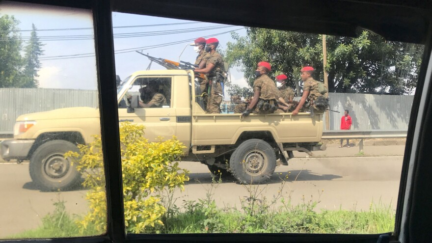 Members of the Ethiopian military ride by on a patrol of Addis Ababa on Thursday. The Ethiopian capital has seen deadly unrest erupt in the wake of the shooting death of Haacaaluu Hundeessaa this week.