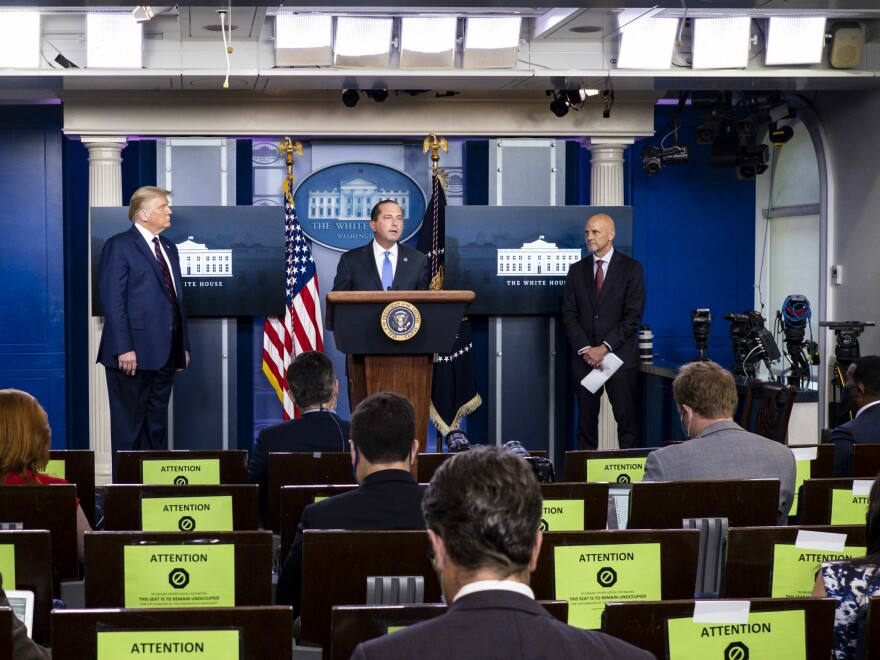 President Donald Trump, left, FDA Commissioner Stephen Hahn, right, and Health and Human Services Secretary Alex Azar, center, announced at a news conference on Sunday that the FDA issued emergency use authorization for convalescent plasma as a COVID-19 treatment.