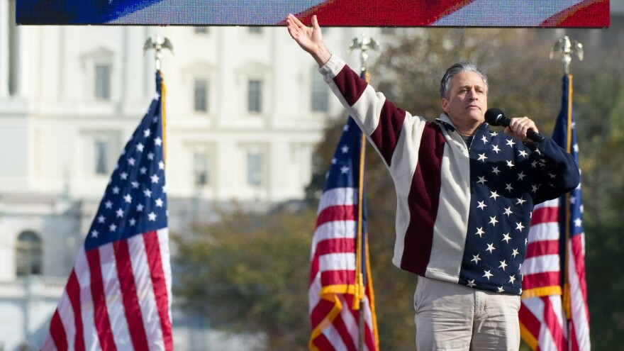 <em>Daily Show</em> host Jon Stewart addresses the crowd at his Rally to Restore Sanity And/Or Fear in Washington, D.C., in 2010.