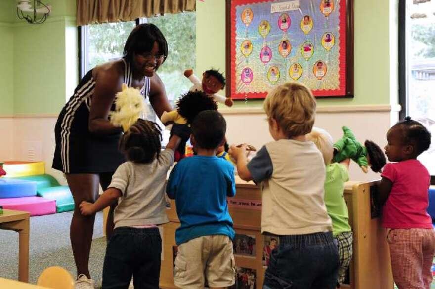 Woman addressing classroom full of children