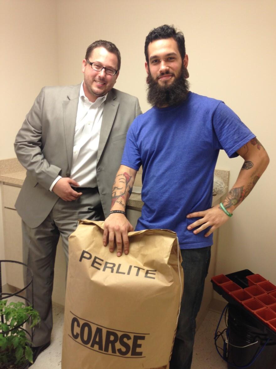 Medical Marijuana Tampa's founder, Jeremy Buffard, left, and Largo branch professor, Jake Howard, show off some school supplies.