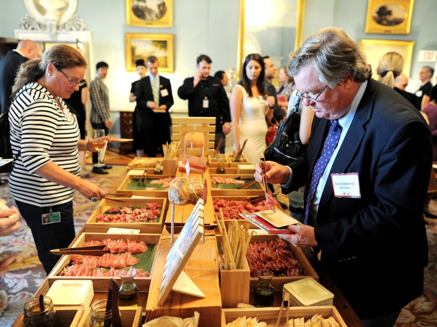 Participants of the Diplomatic Culinary Partnership try different foods at the State Department in Washington during a gathering of the American Chef Corps, a network of chefs from across the U.S.