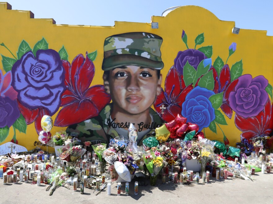 A mural of slain Army Spc. Vanessa Guillén in the south side of Fort Worth, Texas. The Army says it will expand its inquiry into the killing of Guillén, who is one of a string of disappearances and deaths at the Texas post.
