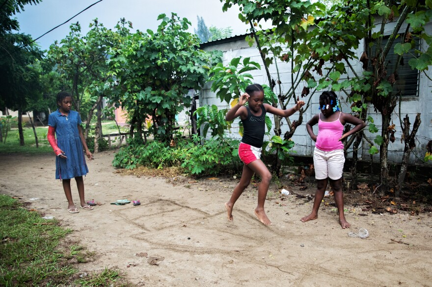 Jirian plays a Garifuna variant of hopscotch with her cousins. Even though she misses her friends in Tegucigalpa, Jirian quickly made new ones in the village of Rio Esteban.