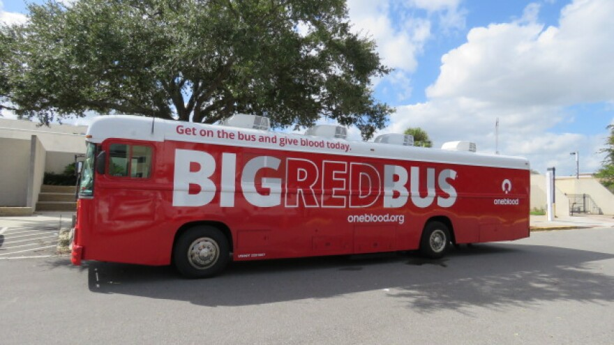 A OneBlood Big Red Bus sitting at FSCJ's Downtown Campus.