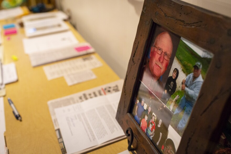 Lisa Hobbs's table is covered with documents and articles relating to her husband and his death. Gene Hobbs was run over by a coworker on a construction site in December 2016.