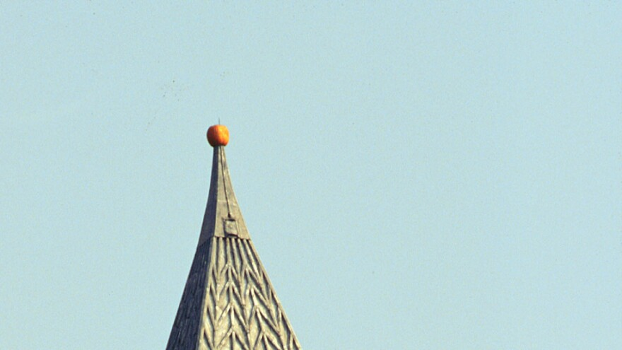 A pumpkin sits perched atop a bell tower on Cornell's campus, where a prankster placed it in Oct. 1997.