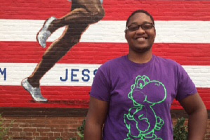 Darryl Reece, 19, helped paint the mural at N. 14th and St. Louis Ave.