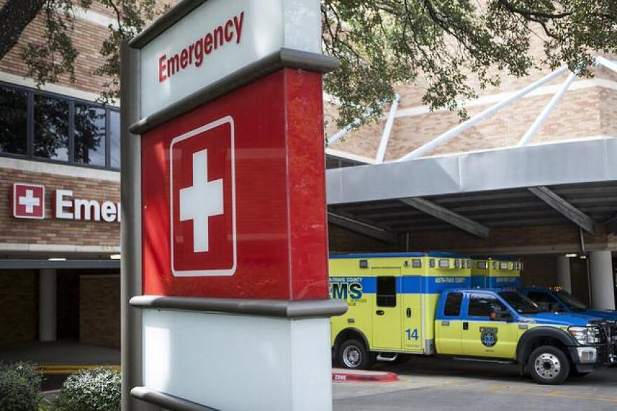 An EMS truck in front of a hospital.