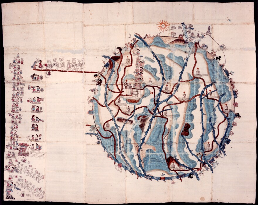 This large, watercolor map of Teozacoalco — made from 23 sheets of European paper pasted together — was created in 1580 by an unknown artist. The figures in the column on the left represent 10 generations of local rulers, the curator explains, including a series of footprints to indicate a marriage alliance with a neighboring town.