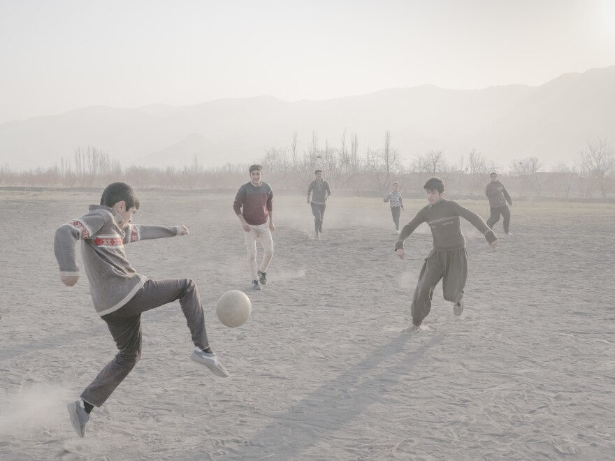 Boys play soccer near the village of Jabal Kandi in their free time on a Friday. Many young people leave the villages once they reach adulthood.