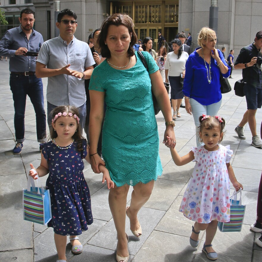 Pablo Villavicencio's wife, Sandra Chica (center) and their two daughters, leave federal court after a hearing on his release Tuesday in New York.