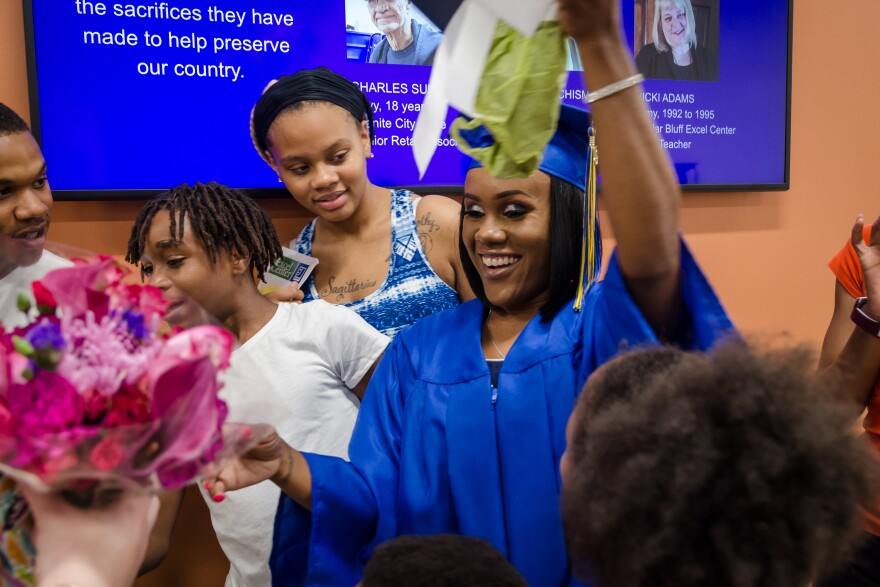 """Amanda McCleary, 33, greets family after earning her high school diploma May 29, 2019. """"The fact that my children are watching me walk across the stage; it just was the icing on the cake,"""" she said."""
