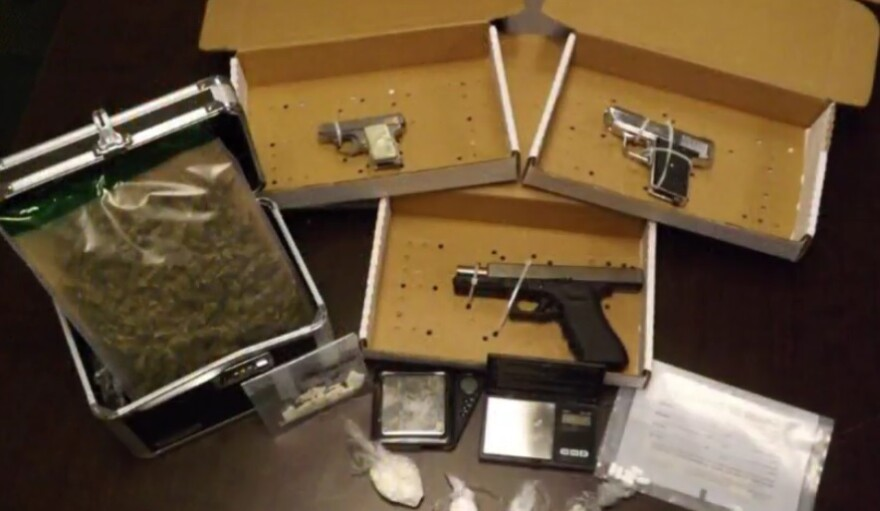 "Drugs and firearms seized as part of ""Operation Spring Cleaning."""