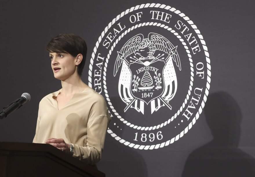 Photo of Angela Dunn speaking behind a podium