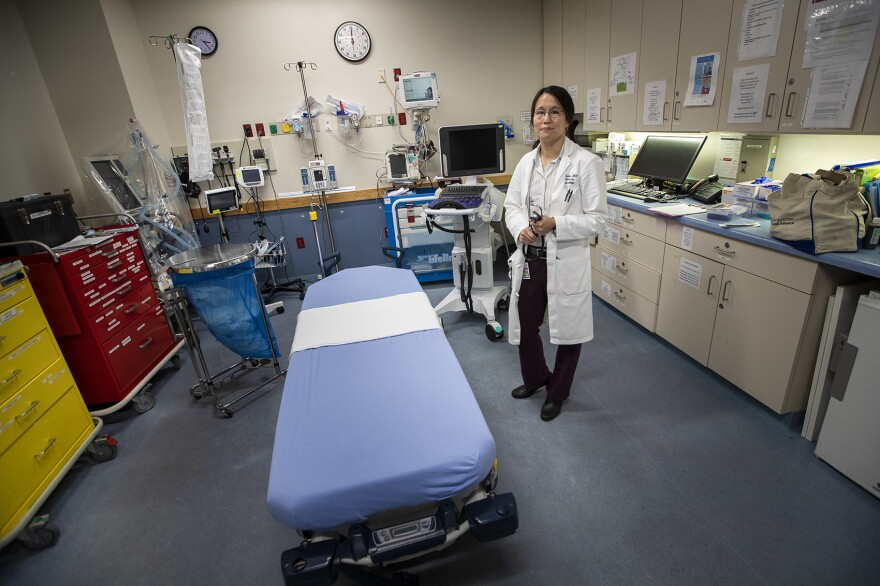 Dr. Melisa Lai-Becker, chief of emergency medicine, stands  in one of the resuscitation rooms in the emergency ward at CHA Everett Hospital, near Boston. In the past 10 years, Lai-Becker says, she hardly saw any stimulant overdoses. These days, there are about four a week.