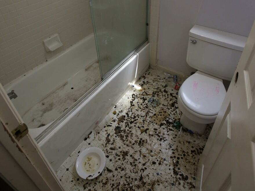 The bathroom of the home in Fairfield, Calif., is strewn with feces.