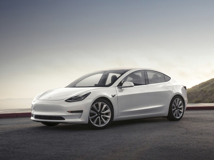This photo provided by Tesla shows the 2017 Model 3, the Silicon Valley automaker's attempt to enter the mainstream car market.