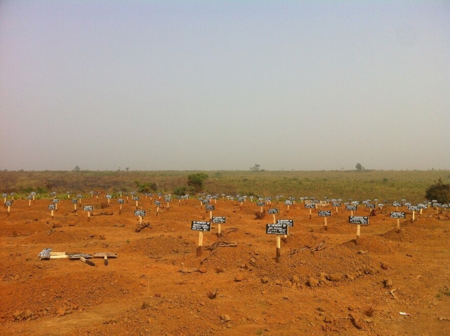 A graveyard down the road from the Port Loko Ebola Treatment Unit that Martha Phillips worked at, in northwestern Sierra Leone. Patients that died at the Ebola Treatment Unit, in their own homes, or at the hospital in town were buried in the cemetery.