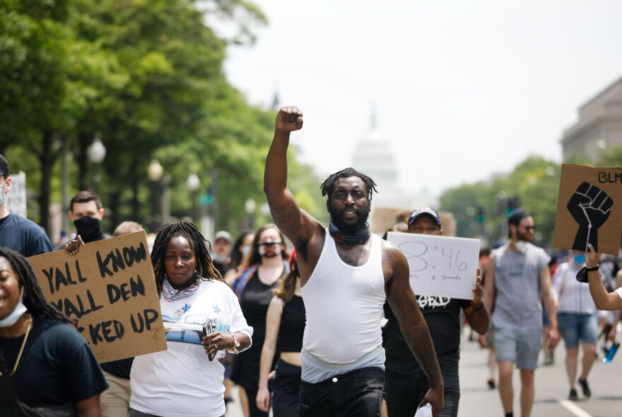 Protester Devonne Perkins, 30, demonstrates against the death of George Floyd and police brutality in Washington, D.C.