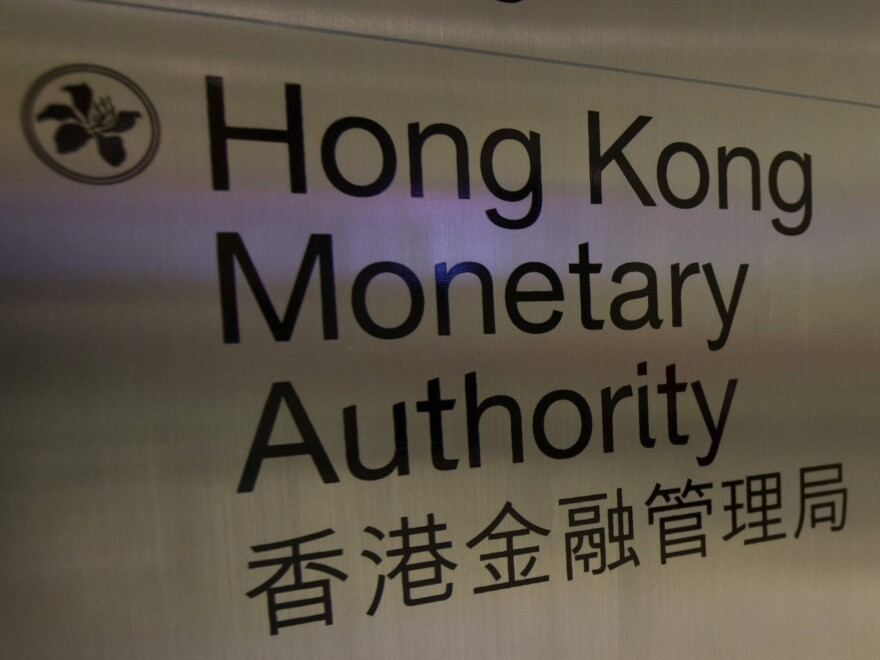 A directory board of Hong Kong Monetary Authority in Hong Kong. The territory's de facto central bank said evidence shows UBS tried to manipulate the interbank lending rate.