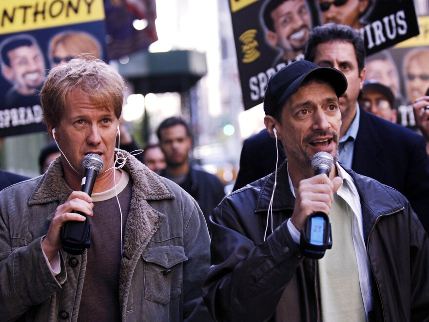 """Radio shock jocks Greg """"Opie"""" Hughes (left) and Anthony Cumia walk to the XM Satellite Radio studios in 2006, in New York. The network fired Cumia on Thursday for what it said were """"racially-charged and hate-filled remarks."""""""