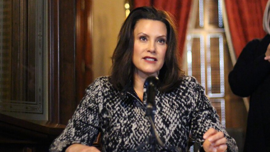 "Michigan Gov. Gretchen Whitmer addresses the state during a speech in Lansing, Mich., on Monday. Whitmer says she's listening to ""the best medical advice"" on when to ease restrictions."