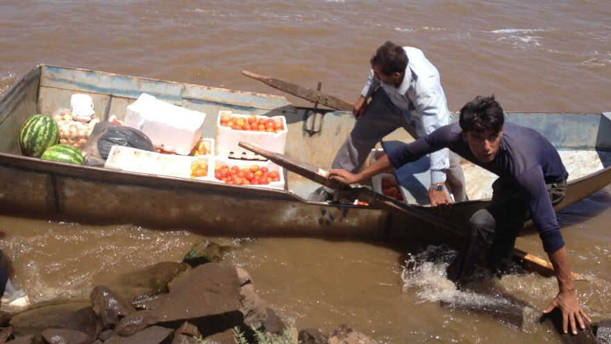 Rebels hold the central Syrian region of Al Houleh, but the area is surrounded by government troops. Supplies have to be smuggled in, like these fruits and vegetables that are being transported across Houleh Lake.