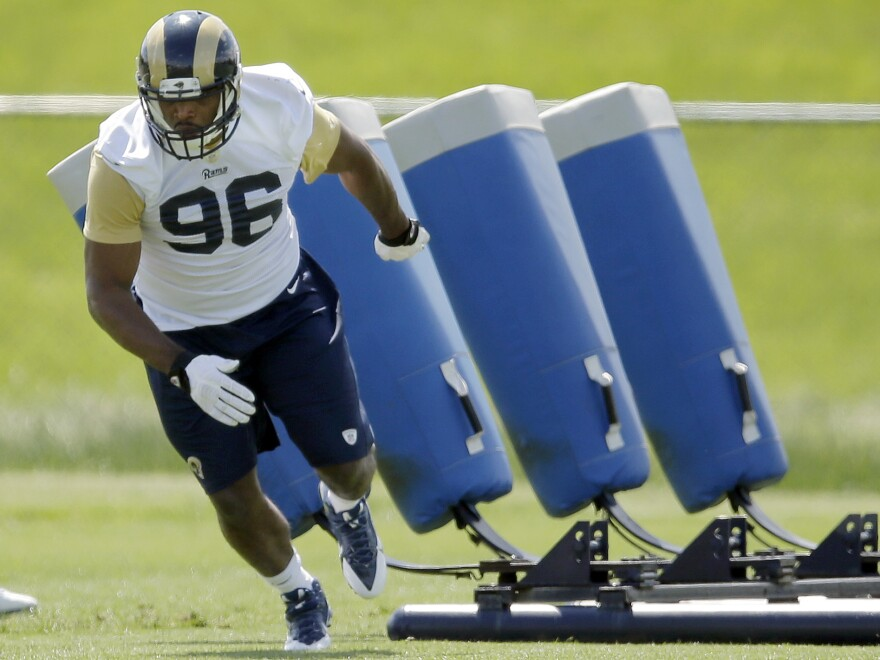 St. Louis Rams rookie defensive end Michael Sam runs a drill during the team's rookie camp. He won't be followed by Oprah channel cameras for a documentary, as had been planned.