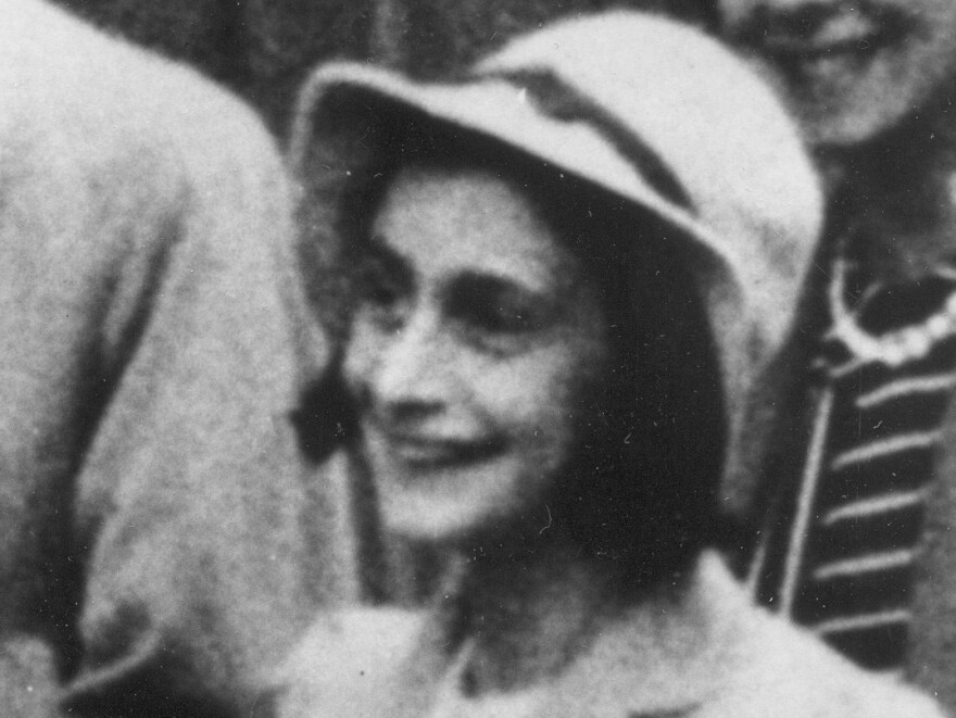 Anne Frank is seen at Amsterdam Town Hall in July 1941.