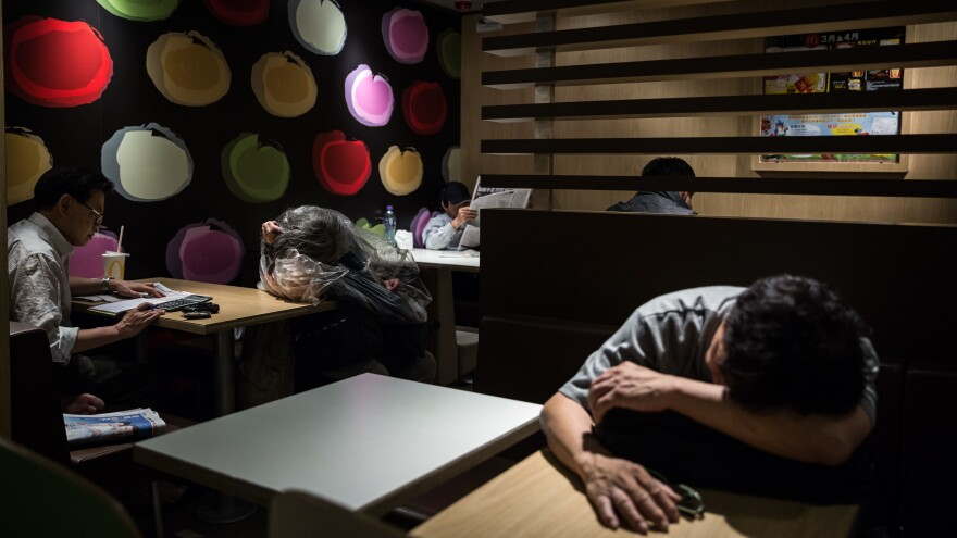 """McRefugees"" sleep at a McDonald's in the Kowloon district of Hong Kong in April 2016."