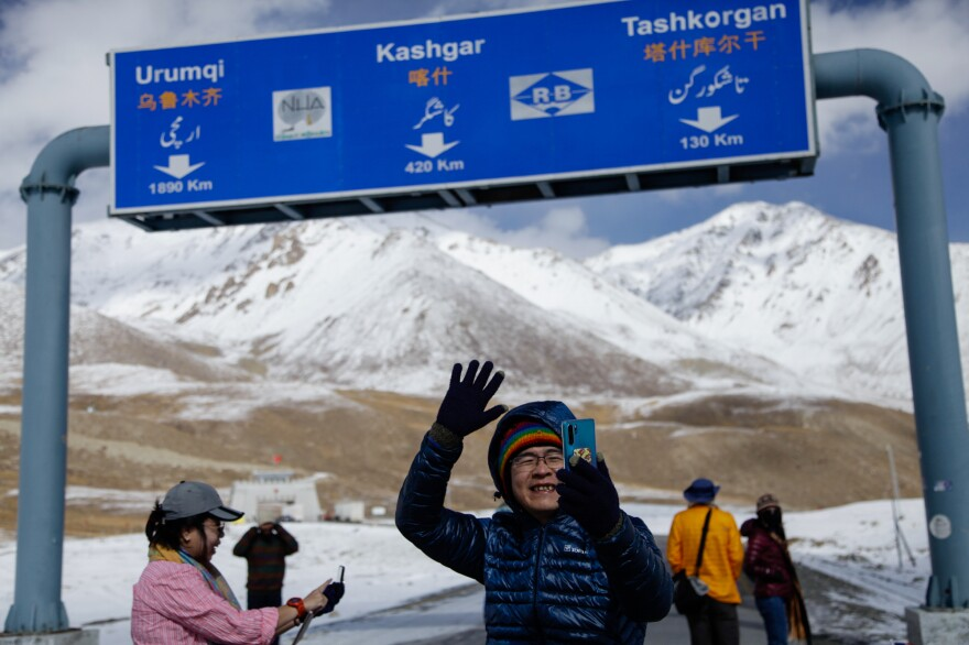Tourists loiter about the Khunjrab Pass — the icy, snowy border crossing between Pakistan and China.