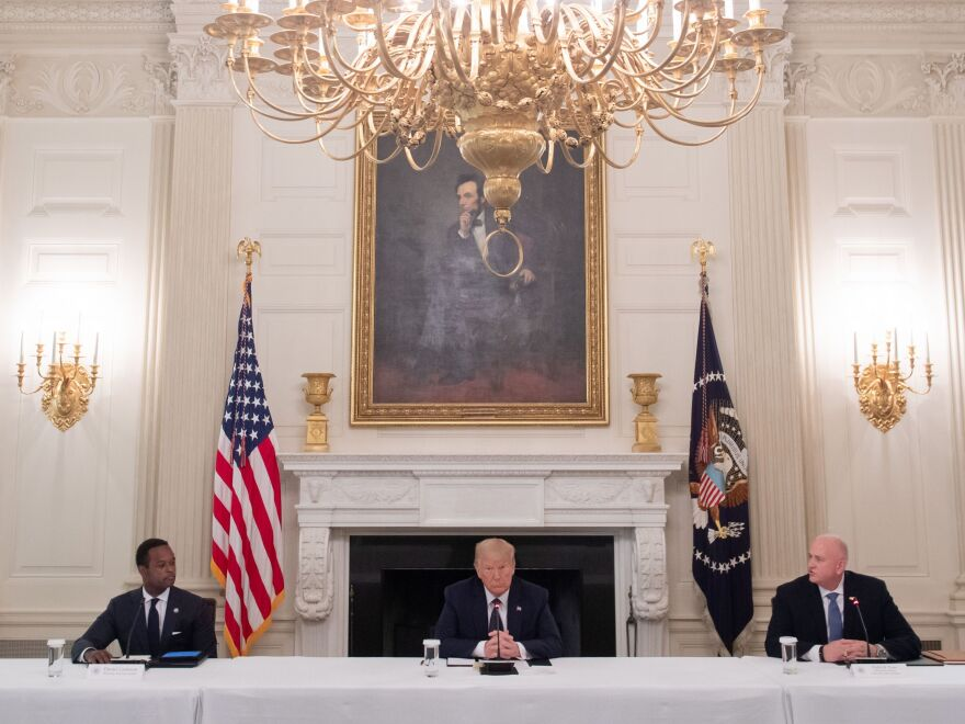 President Trump hosts a roundtable discussion Monday on police and community relations with law enforcement officials in the State Dining Room at the White House.