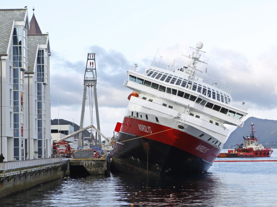 The MS Nordlys sits stricken in the water at Aalesund in western Norway.