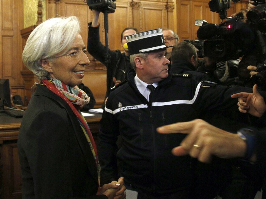 International Monetary Fund chief Christine Lagarde arrives in court on Monday. She is accused of negligence in connection with her oversight of a 2008 case when she was France's finance minister.