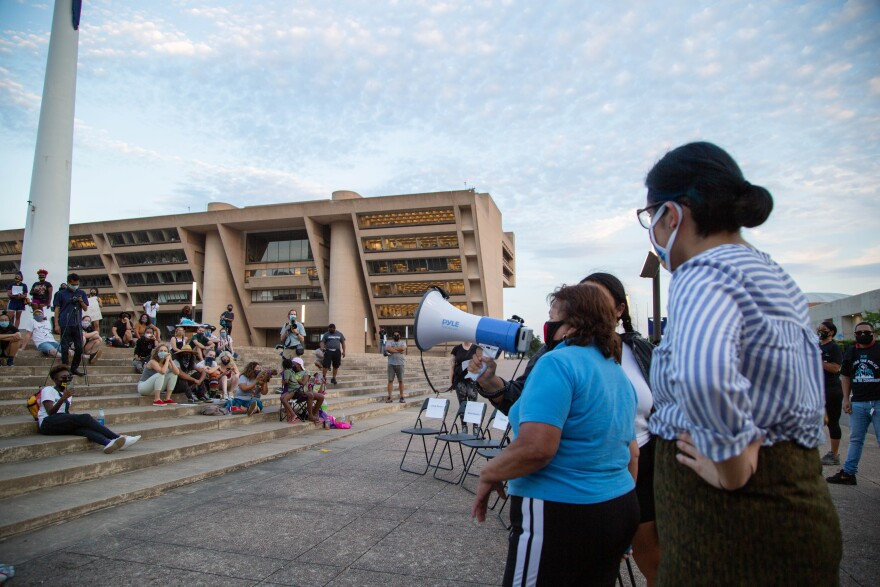 Hispanic residents spoke at Friday's event at Dallas City Hall to demand the city spend money to fix their communities.