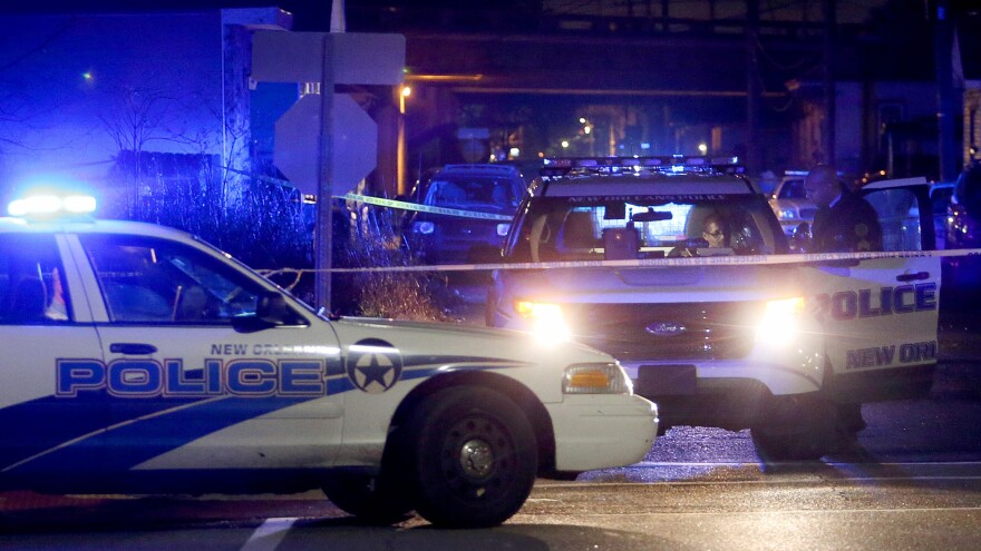 New Orleans police investigate a shooting in February. Though the city's murder rate is down for a second straight year, it's still high compared with other cities.