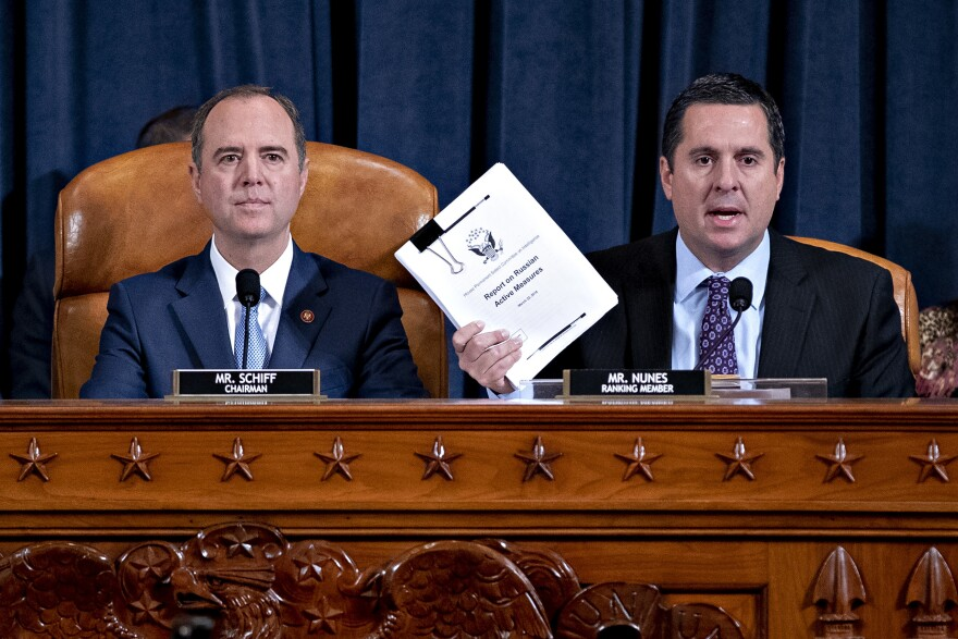 Rep. Devin Nunes, R-Calif., ranking member of the House Intelligence Committee (right), speaks as Rep. Adam Schiff, D-Calif., chairman of the House Intelligence Committee, listens during an impeachment inquiry hearing on Capitol Hill on Nov. 21.