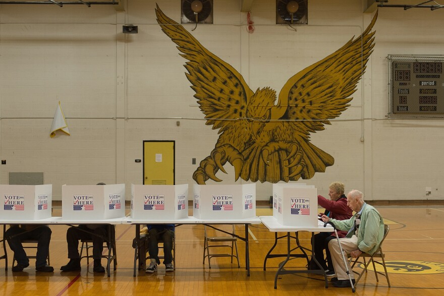 Voters cast their ballots at a polling station at Hazelwood Central High School on November 8, 2016 in Florissant, Missouri. A state judge has ruled state election authorities can no longer tell voters they must show a photo ID to cast a ballot, blocking parts of a law.