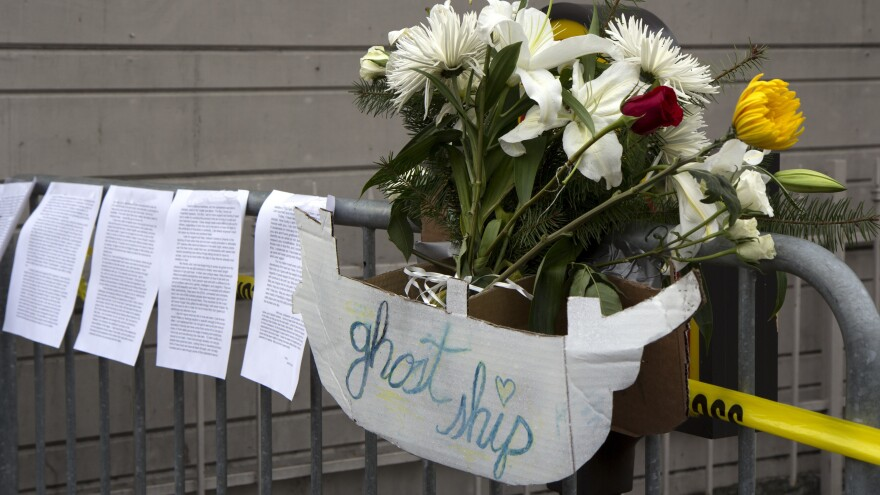"Flowers, letters, and handmade signs were left as a memorial to victims of the fire at the artists' collective known as ""Ghost Ship."""