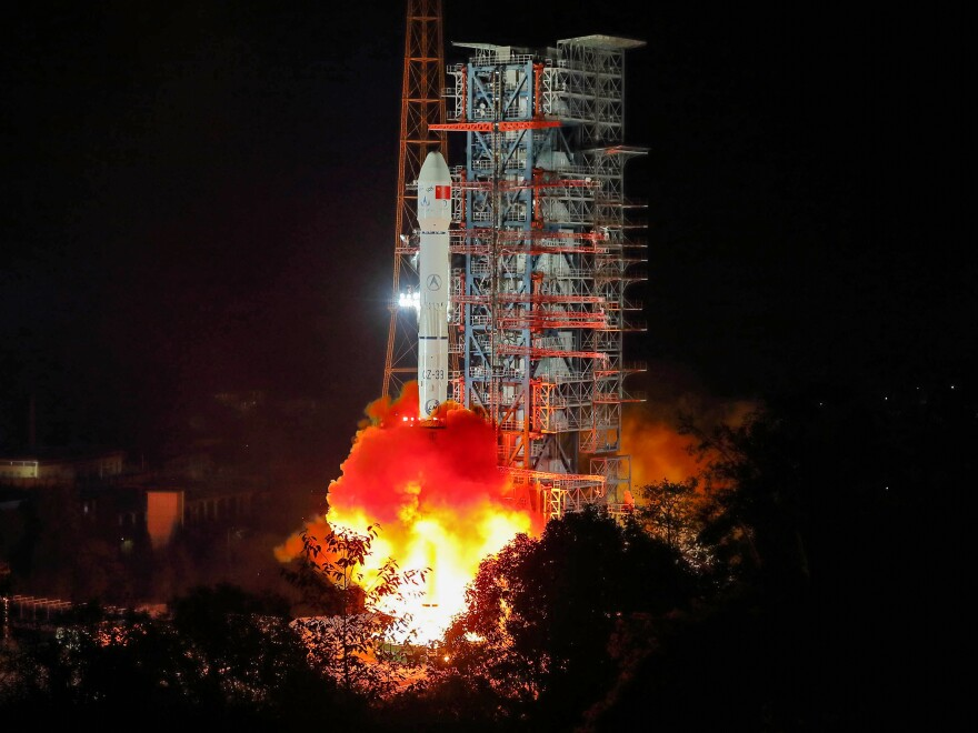 A Long March 3B rocket lifts off from China's Sichuan province early on Dec. 8, carrying a rover destined to land on the far side of the moon.
