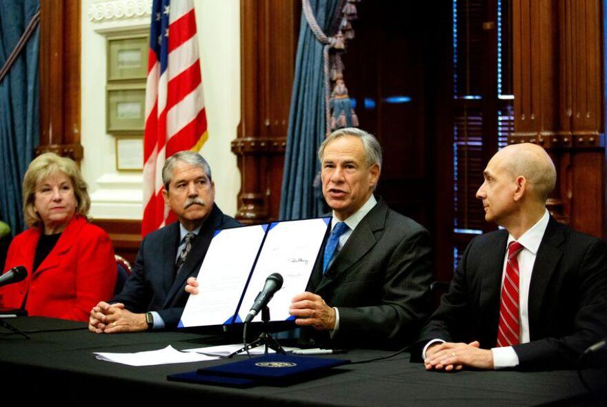 Sen. Jane Nelson, Sen. Larry Taylor, Gov. Greg Abbott and Rep. Greg Bonnen