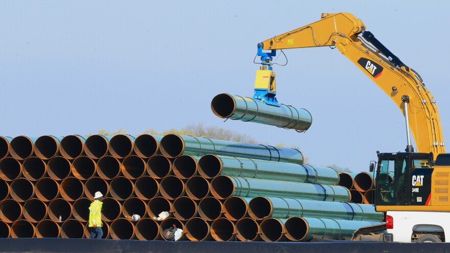 Pipes for the Dakota Access Pipeline are stacked at a staging area in Worthing, S.D., in 2015.