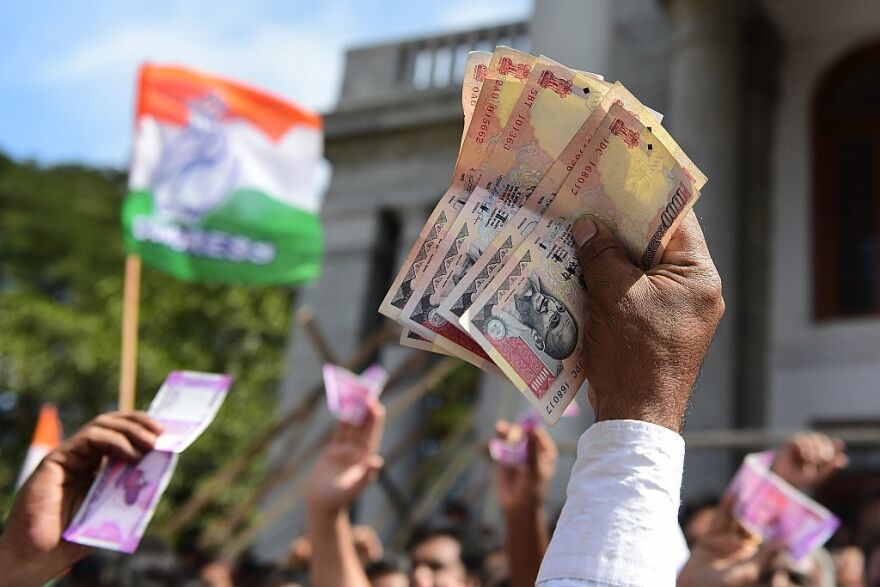 Demonstrators hold Indian currency notes during a protest Monday in Bangalore against the government's decision to void 500- and 1,000-rupee notes.