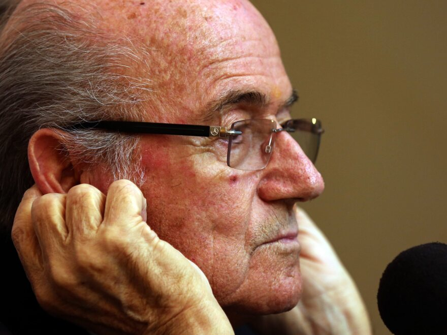 FIFA President Sepp Blatter told a news conference in Colombo, Sri Lanka, on Tuesday that FIFA wasn't responsible for the working conditions of laborers who are building the stadiums for the 2022 World Cup in Qatar. He said the companies that employed the migrant workers should be responsible for their safety.